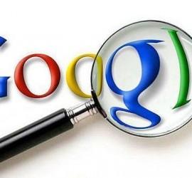 La imagen muestra el logotipo de Google con una lupa sobre él