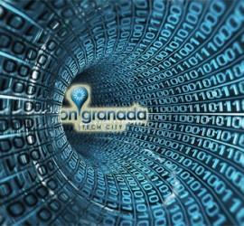 Código informático de un proyectos tecnológico y entre medias el logotipo de onGranada Tech City